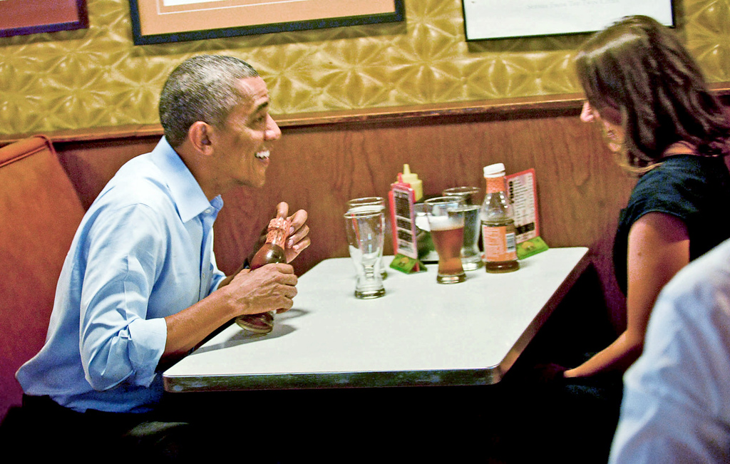 . President Barack Obama has a quick chat with Rebekah Erler of Minneapolis at Matt\'s Bar before going to a town hall meeting at Minnehaha Falls onThursday. Obama met with Erler, who recently wrote the White House about her struggles to make ends meet.(Pioneer Press: Ben Garvin)