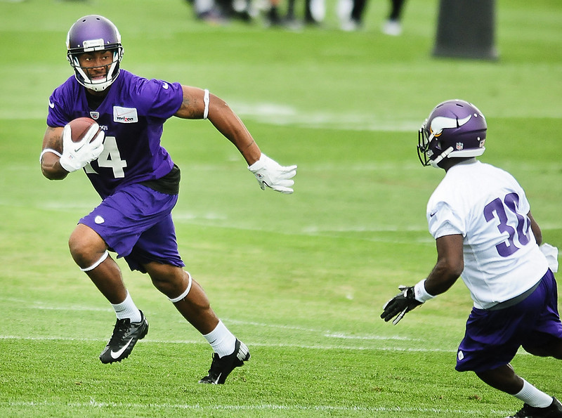 . Minnesota Vikingswide receiver Joe Webb, left, escapes a tackle from cornerback Greg McCoy at Vikings training camp in Mankato, Minn., on Friday, July 26, 2013. (Pioneer Press: Ben Garvin)