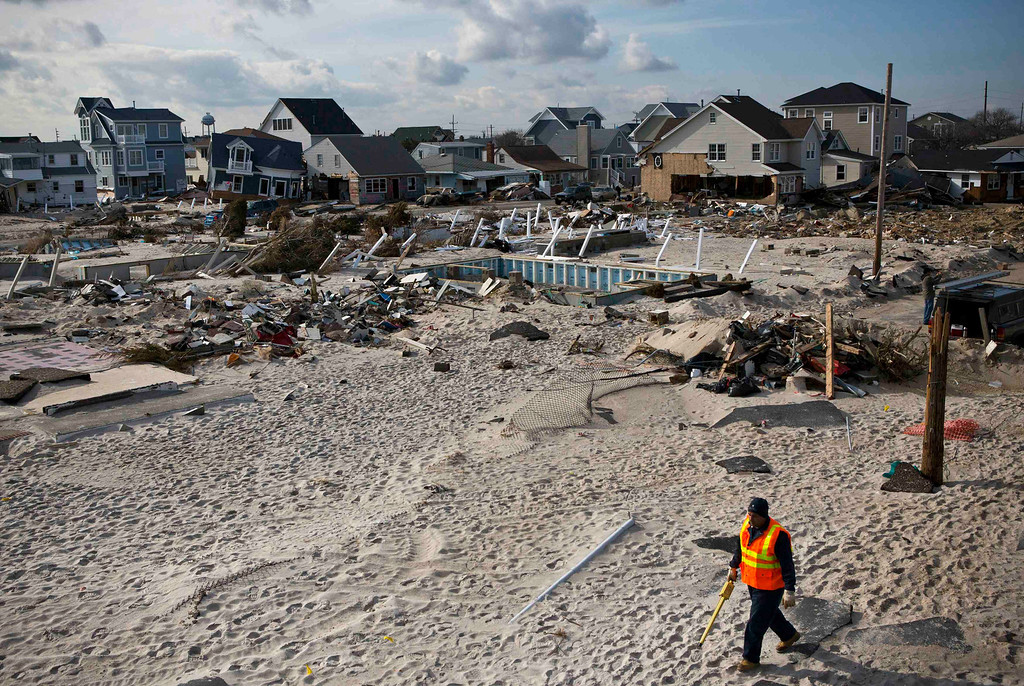 . A man walks amongst properties damaged by Hurricane Sandy in the Ortley Beach area of Toms River, New Jersey November 28, 2012. The storm made landfall along the New Jersey coastline on October 29. REUTERS/Andrew Burton