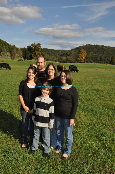 Pat, Leslie and family on the farm.