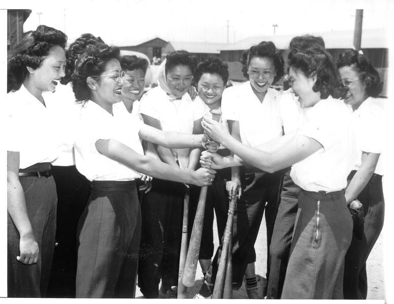 """Japanese Girls' Baseball Team Still Plays"" -- caption on photograph"