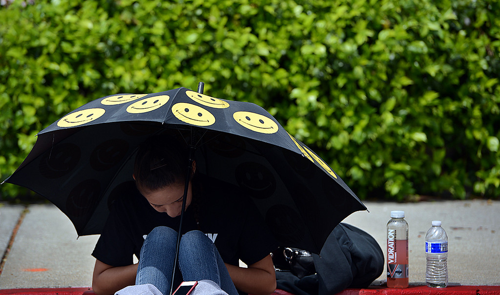 . Yasmine Torres, 13, was working security with her mother Sunday April 7, 2013 during the Redlands Bicycle Classic. Crowds of spectators gathered along the streets of Redlands for the final day of the 29th Annual Redlands Bicycle Classic. Rick Sforza/Staff photographer