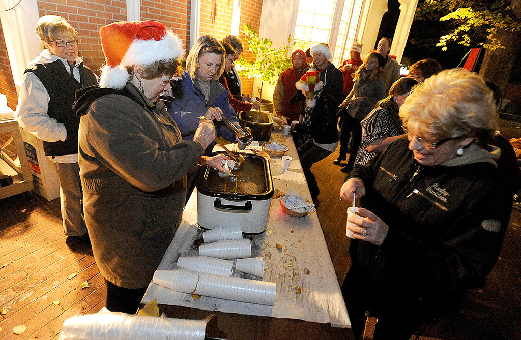 . Volunteers with the Vacaville Museum Guild pass out onion soup in the courtyard of the museum during the 2013 Merriment on Main Celebration on Tuesday, December 3, 2013.  Joel Rosenbaum/JRosenbaum@TheReporter.com