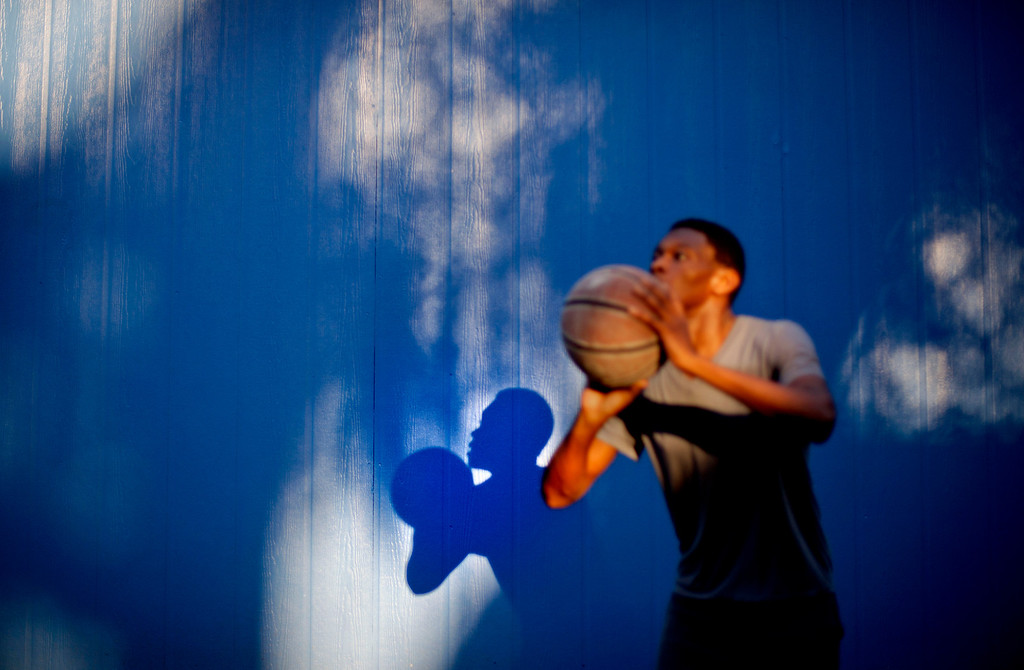 . Marvin Grovner, 16, plays with a basketball after returning home to the Hog Hammock community of Sapelo Island, Ga. from school on the mainland on Wednesday, May 15, 2013. Grovner is one of 47 residents, most of them descendants of West African slaves known as Geechee, who remain on the coastal Georgia island where their ancestors were brought to work on a plantation in the early 1800s. (AP Photo/David Goldman)