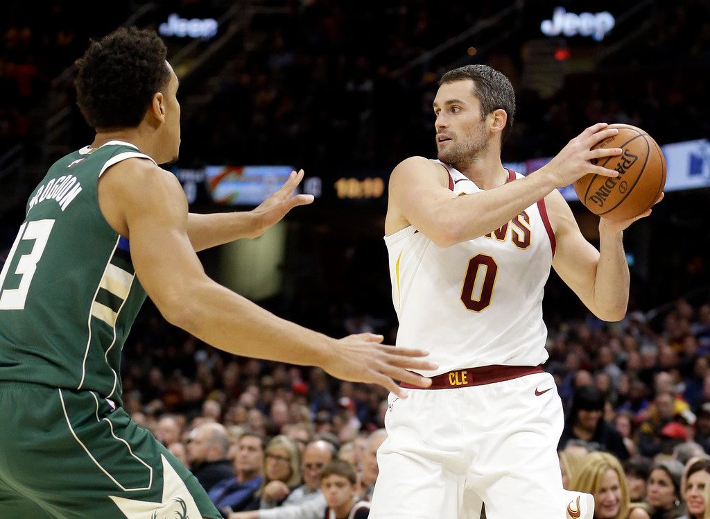 . Cleveland Cavaliers\' Kevin Love (0) looks to pass against Milwaukee Bucks\' Malcolm Brogdon (13) in the first half of an NBA basketball game, Tuesday, Nov. 7, 2017, in Cleveland. (AP Photo/Tony Dejak)