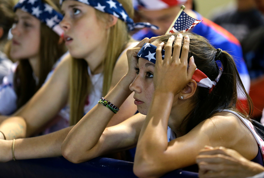 . Fans at a viewing party in Seattle react after Belgium\'s first goal against the United States in a round of 16 World Cup soccer match, Tuesday, July 1, 2014. Belgium won 2-1. (AP Photo/Ted S. Warren)