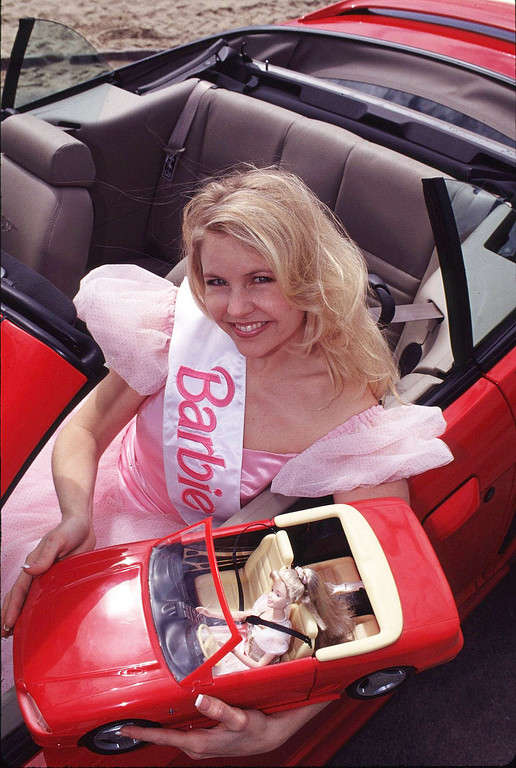 . Two American Favorites -- Barbie Doll And The Ford Mustang -- Celebrate Birthdays In 1999. As Barbie Doll Marks A 40Th Anniversary This Year, Admiring Fans Are Wishing Her Well Around The Globe. Ford Mustang Is Celebrating A Very Special 35Th Birthday On April 17 And To Share In The Festivities, The Two Got Together In Southern California, With Their Smaller Counterparts.  (Photo By Getty Images)