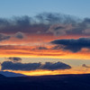 Mountain Range Silhouette and Sunrise Colored Clouds