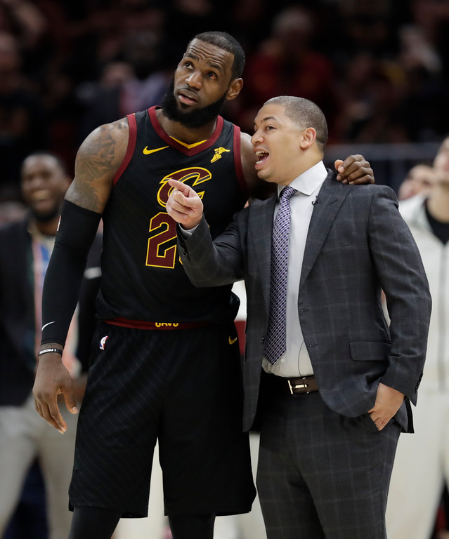 . Cleveland Cavaliers coach Tyronn Lue talks with LeBron James during the second half of Game 3 of basketball\'s NBA Finals against the Golden State Warriors, Wednesday, June 6, 2018, in Cleveland. (AP Photo/Tony Dejak)