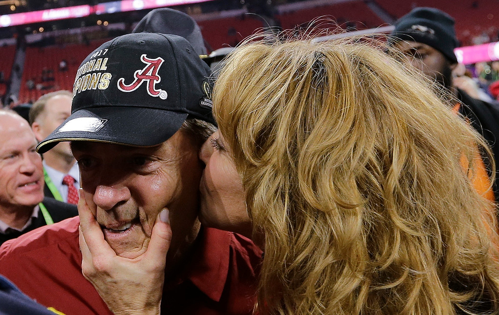 . Alabama head coach Nick Saban gets a kiss after overtime of the NCAA college football playoff championship game against Georgia Monday, Jan. 8, 2018, in Atlanta. Alabama won 26-23. (AP Photo/David J. Phillip)