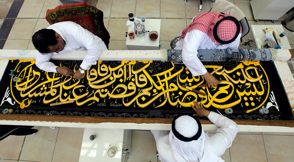 . Saudi workers embroider Islamic calligraphy, using either pure silver threads or silver threads covered with gold, on the final stages in the preparation of a drape, or Kiswa, that covers the Kaaba, a cube-shaped structure at the heart the Grand Mosque, at the Kiswa factory in Mecca, Saudi Arabia, Sunday, Oct.6, 2013. The Kiswa covering the Kaaba, is changed every year marking Muslims annual Hajj or pilgrimage which will fall this year on Oct.14. (AP Photo/Amr Nabil)