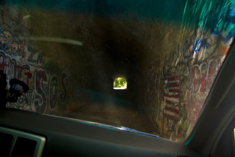 Through the windshield. A graffiti filled tunnel.