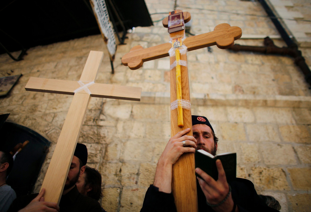 . Orthodox Christian worshippers hold crosses as they take part in the Eastern and Orthodox Church\'s Good Friday procession along the Via Dolorosa in Jerusalem\'s Old City May 3, 2013. Thousands of worshippers retraced the route Jesus took along the Via Dolorosa to his crucifixion in the Church of the Holy Sepulchre. REUTERS/Ammar Awad