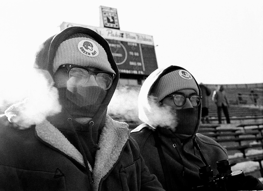 . Two Green Bay Packers fans, Tom, left, and Richard Bulgrin, blow steam through their face protectors in the below-zero temperature at Lambeau Field in Green Bay, Wisc., Dec. 31, 1967, scene of the NFL championship game between the Packers and the Dallas Cowboys. (AP Photo)