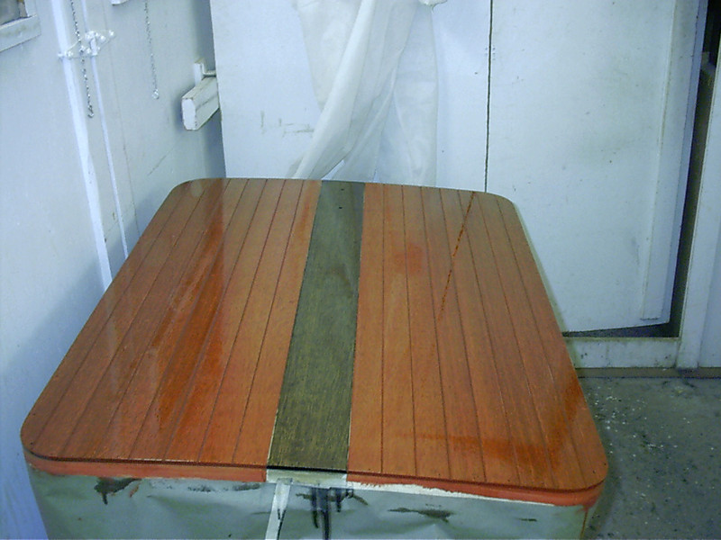 Engine hatch cover with both colors of stain and two coats of varnish.