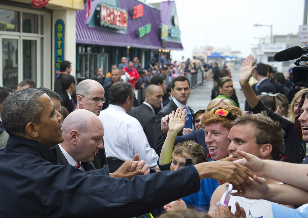 . US President Barack Obama greets people along the boardwalk as he views rebuilding efforts following last year\'s Hurricane Sandy in Point Pleasant, New Jersey, on May 28, 2013.    AFP PHOTO / Saul LOEB/AFP/Getty Images