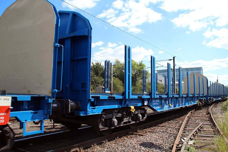 New Colas Log Wagon IWA 83.84.3523030-8 on 6z47 Dollands Moor-Gloucester passing Mitre Bridge Jct 31/08/12.