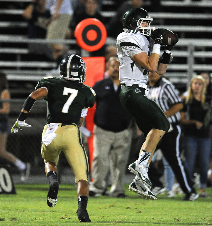 . Bonita\'s Richie Cochran (40) catches a pass for a first down over South Hills\' Quinn Cotter (7) in the first half of a prep football game at Covina District Field in Covina, Calif. on Friday, Sept. 6, 2013.   (Photo by Keith Birmingham/Pasadena Star-News)