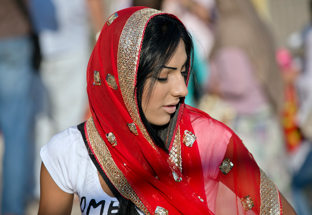 . A Muslim girl wears a traditional scarf while taking part in Eid al-Fitr prayers in Bucharest, Romania, Thursday, Aug. 8, 2013. Muslim men and women joined prayers at the Dinamo stadium in the Romanian capital, in the largest Muslim public gathering of the year. Eid al-Fitr marks the end of the holy month of Ramadan, during which Muslims all over the world fast from sunrise to sunset. (AP Photo/Vadim Ghirda)