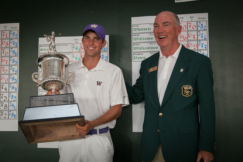 """WGA Chairman Jim Bunch and Chris Williams hold the """"Cameron Eddy Trophy"""" after Williams won the trophy for the second year in a row as the low medalist at the 2012 Western Amateur Championship at Exmoor Country Club in Highland Park IL. on Thursday, August 2, 2012. (WGA Photo/Charles Cherney)"""