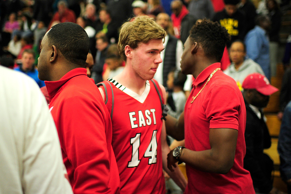 . CENTENNIAL, CO - MARCH 2: Scotty Wiese (14) of Denver East walks off the court after lossing to Eaglecrest at Eaglecrest High School on March 2, 2016 in Centennial, Colorado. Eaglecrest defeated Denver East 56-46. (Photo by Brent Lewis/The Denver Post)