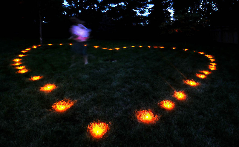 . Groom Bradley Weber\'s niece, Hayley LaZarre, 13, puts the final touches on a heart made of LED lights at a pre-wedding party at their home in Eden Prairie on Wednesday, July 31, 2013. (Pioneer Press: Sherri LaRose-Chiglo)