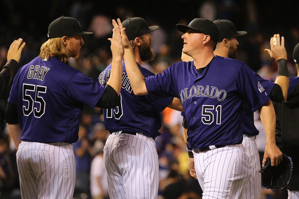 . DENVER, CO - APRIL 22:  Jon Gray #55 and Jake McGee #51 of the Colorado Rockies celebrate their victory over the Los Angeles Dodgers at Coors Field on April 22, 2016 in Denver, Colorado. The Rockies defeated the Dodgers 7-5. (Photo by Doug Pensinger/Getty Images)