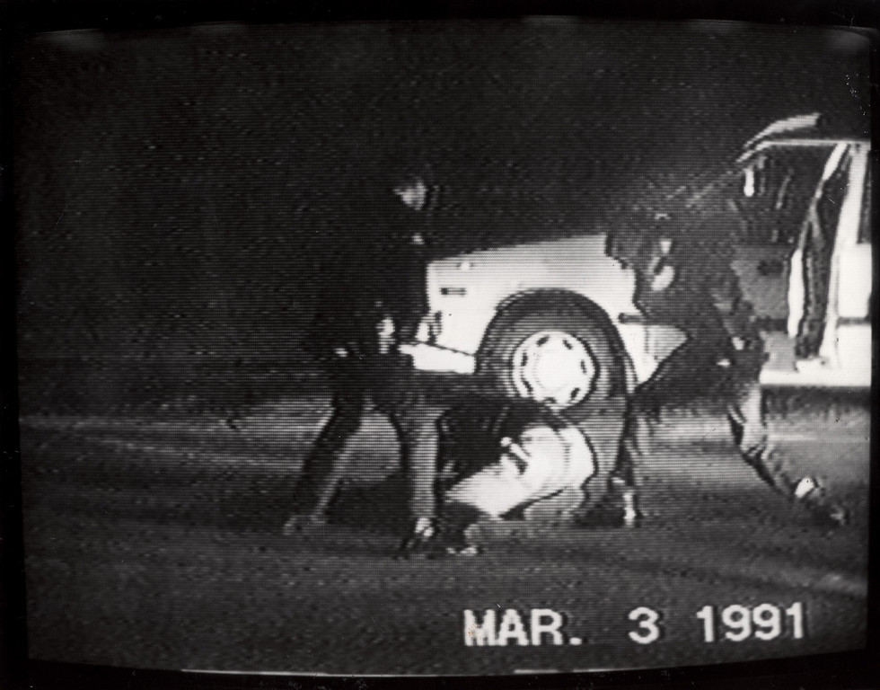 . A photo taken from the videotape shows Rodney king being beaten on March 3, 1991 in lake View Terrace. The acquittal of four Los Angeles police officers in the beating of Rodney King sparked the 1992 Los Angeles riots.  (Los Angeles Daily News file photo)