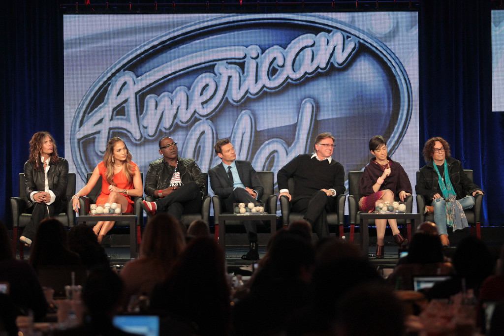 . PASADENA, CA - JANUARY 08:  (L-R) Judges Steven Tyler, Jennifer Lopez, Randy Jackson, host Ryan Seacrest, executive producers Ken Warick, Cecile Frot-Coutaz, and FOX president of alternative entertainment Mike Darnell speak onstage during the \'American Idol\' panel during the FOX Broadcasting Company portion of the 2012 Winter TCA Tour at The Langham Huntington Hotel and Spa on January 8, 2012 in Pasadena, California.  (Photo by Frederick M. Brown/Getty Images)