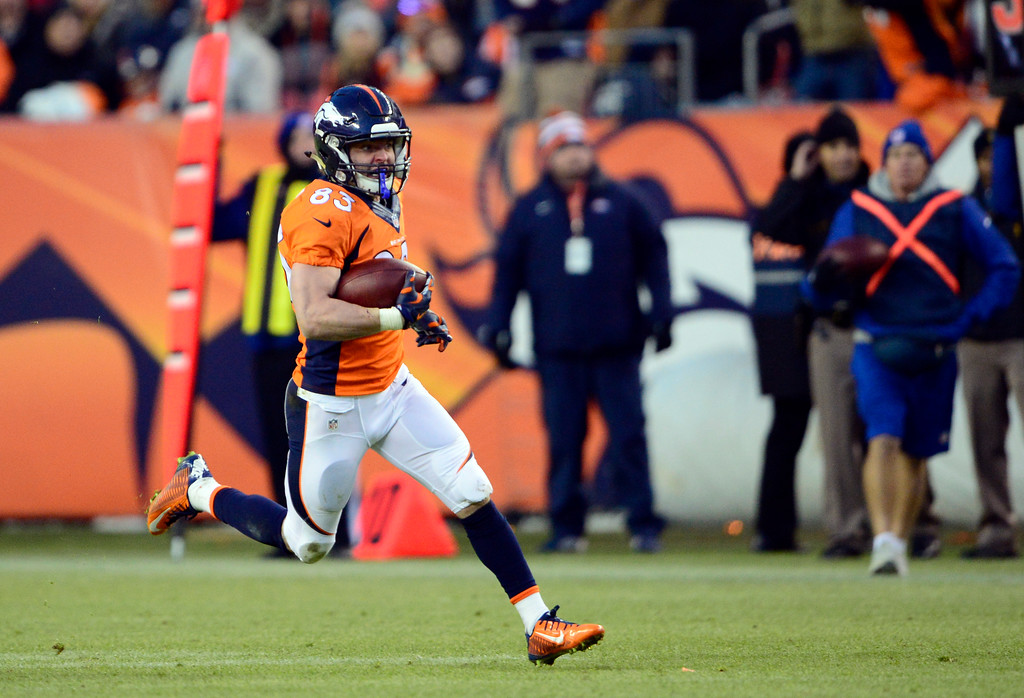 . DENVER, CO - DECEMBER 28: Wes Welker (83) of the Denver Broncos completes a pass and runs the ball during the third quarter.  The Denver Broncos played the Oakland Raiders at Sports Authority Field at Mile High in Denver on December, 28 2014. (Photo by Joe Amon/The Denver Post)