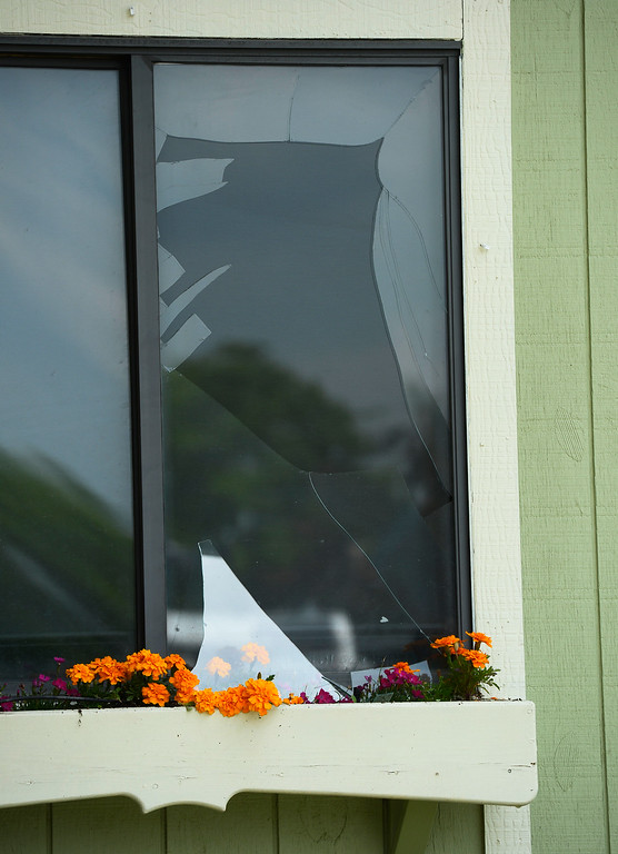 . A window is blown out next to the house that exploded.  (Photo By Andy Cross/The Denver Post)