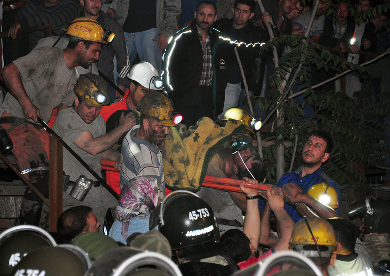 . Miners carry a rescued friend after an explosion and fire at a coal mine killed at least 17 miners and left up to 300 workers trapped underground, in Soma, in western Turkey, Tuesday, May 13, 2014, a Turkish official said. Twenty people were rescued from the mine but one later died in the hospital, Soma administrator Mehmet Bahattin Atci told reporters. The town is 250 kilometers (155 miles) south of Istanbul. The death toll was expected to rise.(AP Photo/IHA) TURKEY OUT