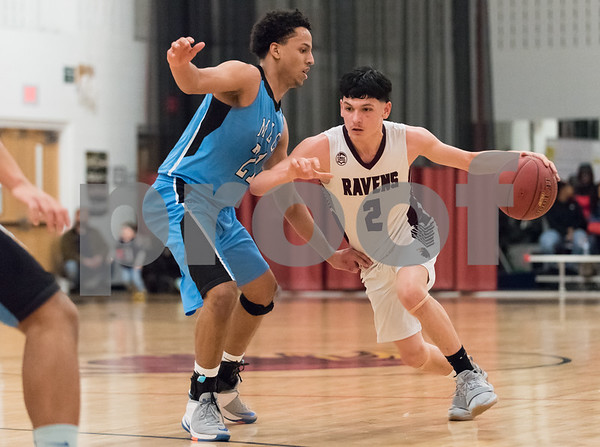 02/02/18 Wesley Bunnell | Staff Innovation boys basketball vs MLC on Friday evening at Innovation High School. Carlos Gonzalez (2).