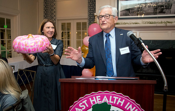 10/10/19 Wesley Bunnell | StaffrrThe CT Breast Health Initiative held their award dinner at Shuttle Meadow Country Club to honor their donors. Coleman Levy, R, helps raise money for the CTBHI by auctioning off decorated pumpkins held by Linda Rocco, L, at the end of the dinner.