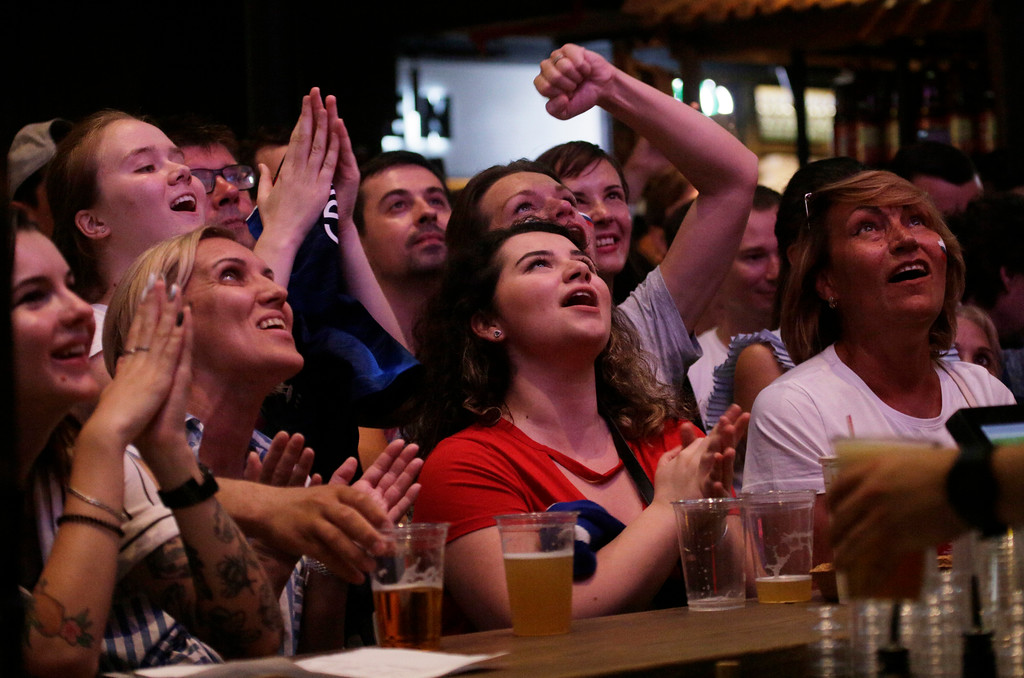 . People watch the final match between France and Croatia at the 2018 soccer World Cup in a bar in Moscow, Russia, Sunday, July 15, 2018. (AP Photo/Dmitri Lovetsky7