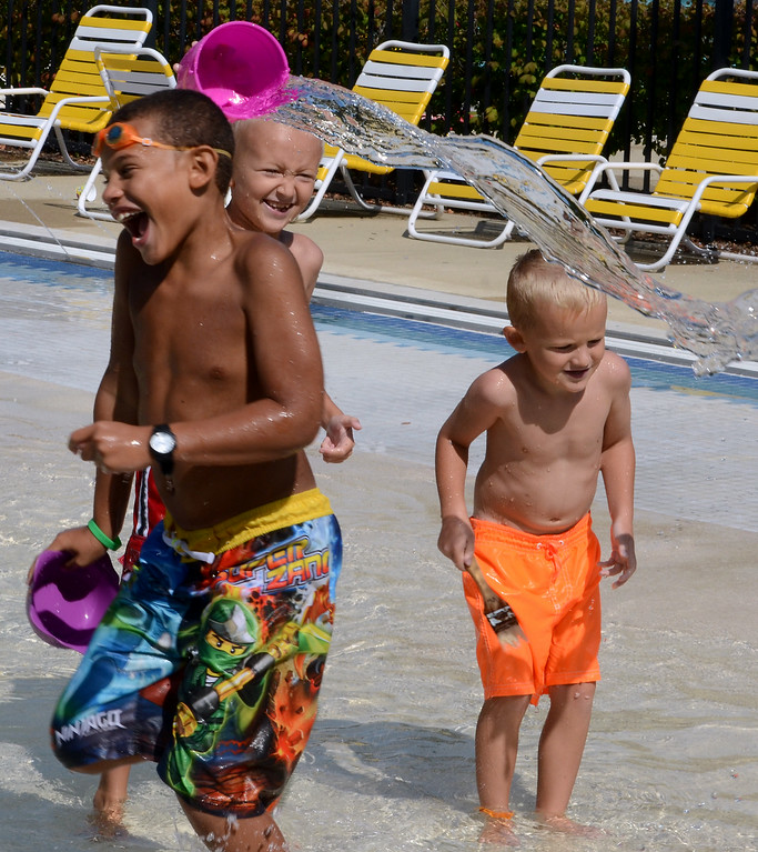 . Anthony Hall (L) and brothers Aidan (center) and Aren Ashley play at the Fourth Street Pool in Lansdale as they cool off on a hot and sunny Tuesday afternoon August 26,2014. Photo by Mark C Psoras