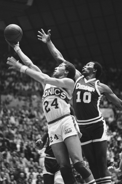 . 29. Dennis Johnson, shown at left (Associated Press file)