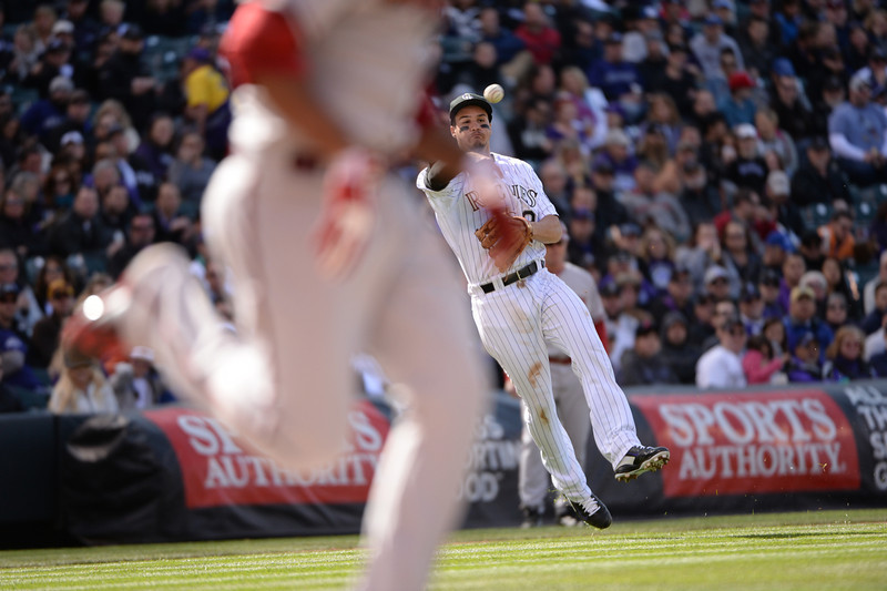 . Rockies third baseman Nolan Arenado (28) throws to first base for an out during the fifth inning. The Colorado Rockies hosted the Arizona Diamondbacks in the Rockies season home opener at Coors Field in Denver, Colorado Friday, April 4, 2014. (Photo by Hyoung Chang/The Denver Post)