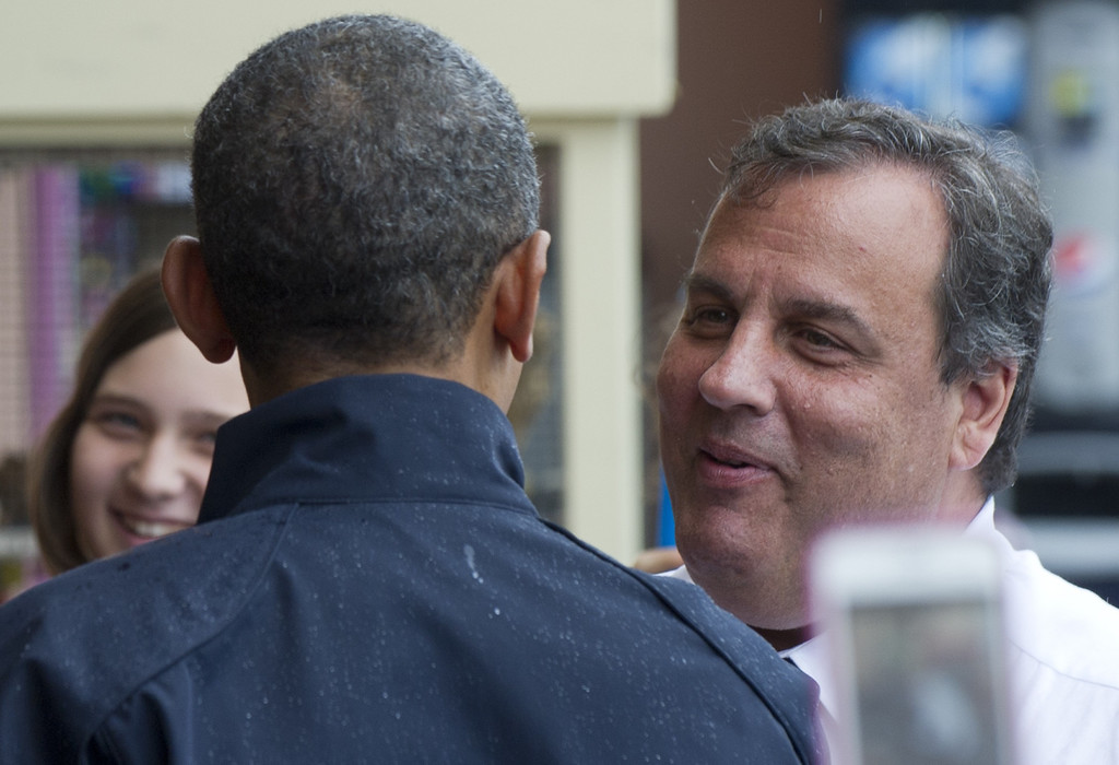 . US President Barack Obama and New Jersey Governor Chris Christie talk on the boardwalk as they view rebuilding efforts following last year\'s Hurricane Sandy in Point Pleasant, New Jersey, on May 28, 2013.   AFP PHOTO / Saul LOEB/AFP/Getty Images