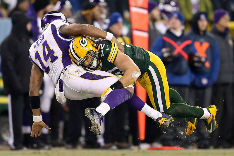 . Quarterback Joe Webb #14 of the Minnesota Vikings is hit by outside linebacker Clay Matthews #52 of the Green Bay Packers after throwing the ball in the second half during the NFC Wild Card Playoff game at Lambeau Field on January 5, 2013 in Green Bay, Wisconsin.  (Photo by Andy Lyons/Getty Images)