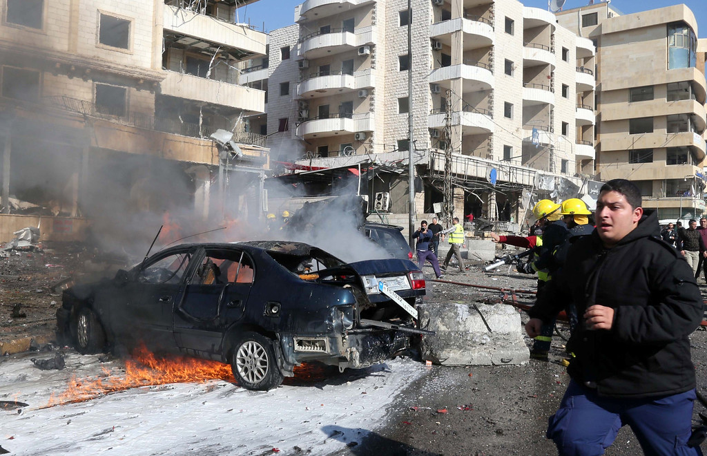 . Lebanese emergency personnel work at the site of a bomb explosion in a southern suburb of the capital Beirut on February 19, 2014. AFP PHOTO / STR-/AFP/Getty Images