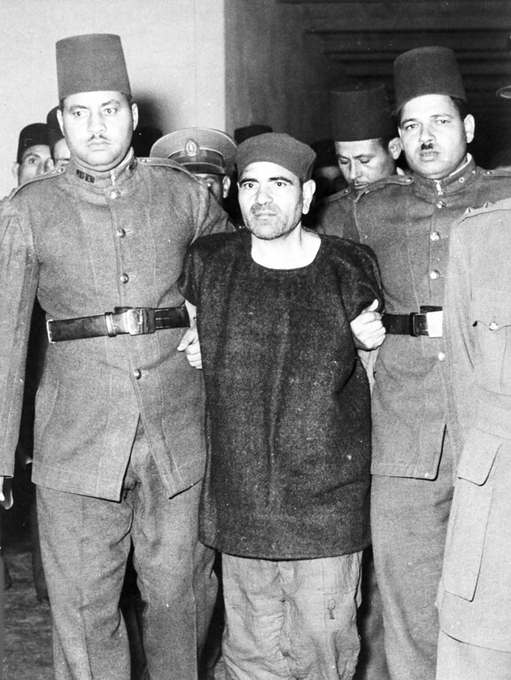 . Mohammed Farghali, centre, a Muslim Brotherhood leader, found guilty planning the  attempted assassination of Egyptian Premier Gamal Abdel Nasser at Alexandria on Oct. 26th, is escorted to the execution chamber, in a Cairo Prison, Dec. 7, 1954, where he was hung. (AP Photo)