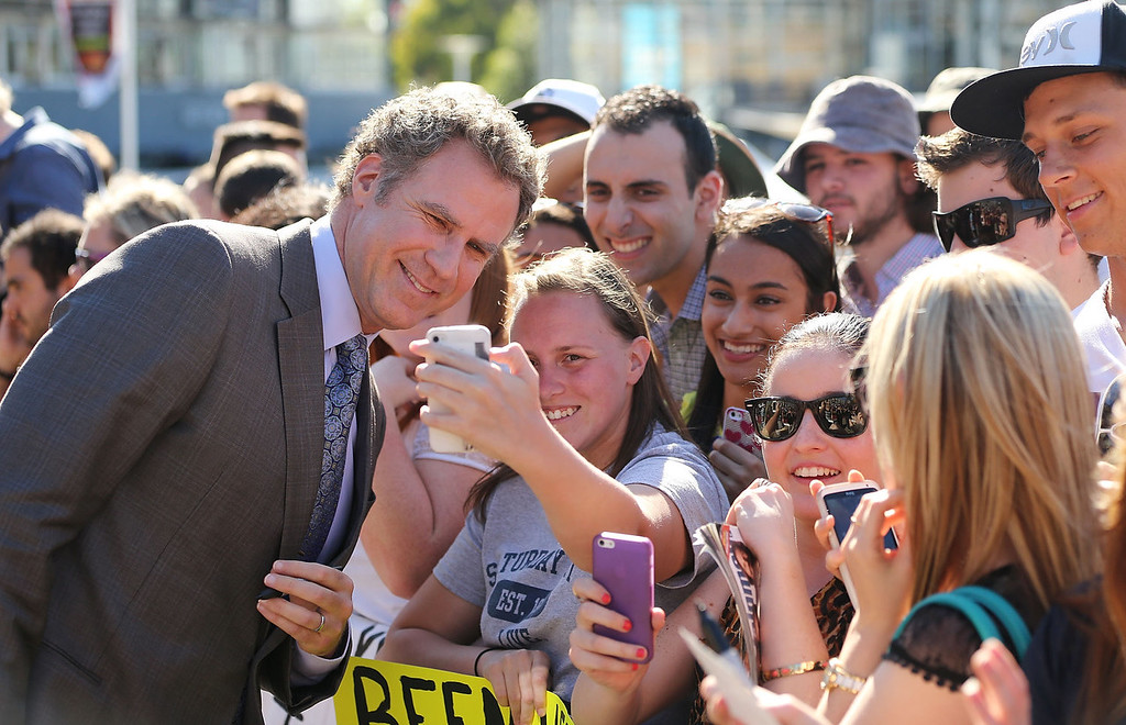 ". Will Ferrell signs autographs for fans at the ""Anchorman 2: The Legend Continues\"" Australian premiere on November 24, 2013 in Sydney, Australia.  (Photo by Mark Metcalfe/Getty Images for Paramount Pictures International)"