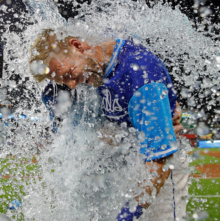 . Kansas City Royals\' Hunter Dozier is doused after the team\'s baseball game against the Cleveland Indians on Friday, Aug. 24, 2018, in Kansas City, Mo. Dozier had a walk-off home run, giving the Royals a 5-4 victory. (AP Photo/Charlie Riedel)