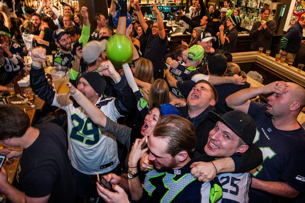 . Seattle Seahawks fans celebrate their team\'s victory over the Denver Broncos in Super Bowl XLVIII at a downtown sports bar in Seattle, Washington on in Seattle, Washington on Sunday, Feb. 2, 2014. EPA/DAN LEVINE