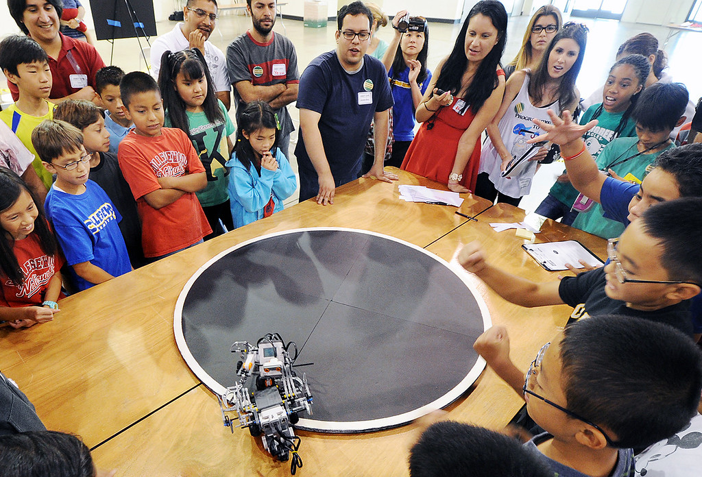 """. Collegewood Elementary of Walnut Valley, with their entry \""""Exterminators\"""", winning this round of WAROBOTS, and finishing second in competition. Cal Poly Pomona\'s Robotics Initiative invited 200 elementary and middle school students to a Robot Expo at LA Fairplex in Pomona Monday, May 20, 2013. (SGVN/Photo by Walt Mancini)"""