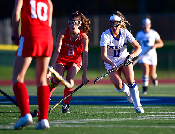 10/15/2019 Mike Orazzi | StaffrConard High Schools Caroline Kumpa (8) and Southington High Schools Jenna Sheehan (11) during a 2-2 tie in field hockey action in Southington on Tuesday afternoon. r