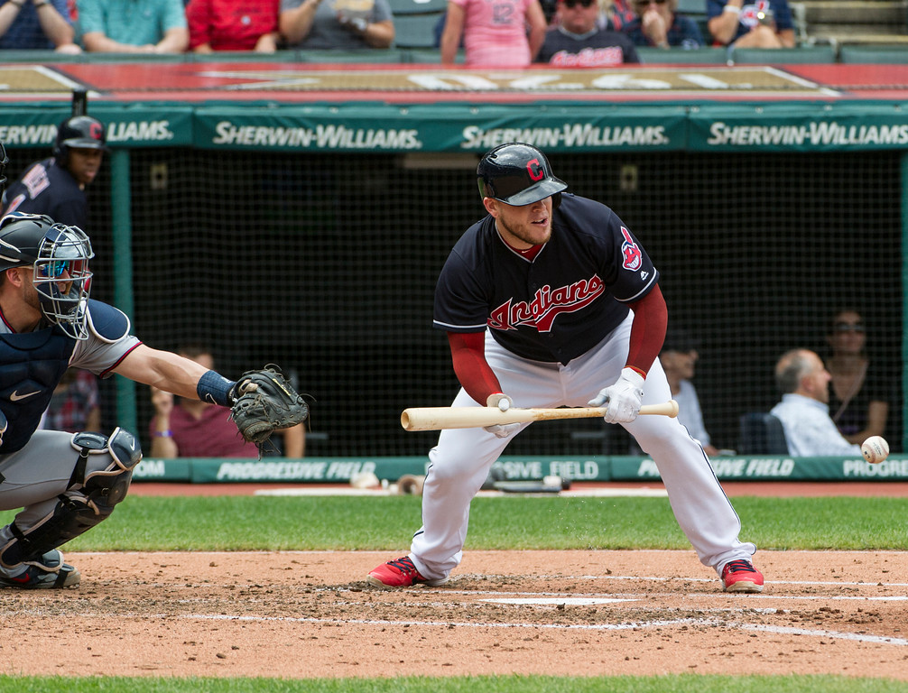 . Cleveland Indians\' Roberto Perez lays down a sacrifice bunt as Minnesota Twins catcher Mitch Garver watches during the third inning of a baseball game in Cleveland, Thursday, Aug. 30, 2018. The bunt moved Indians\' Jason Kipnis to third base. (AP Photo/Phil Long)