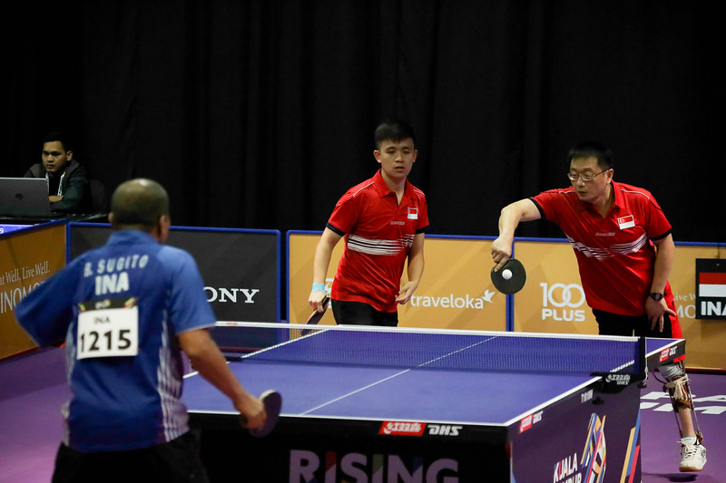 PARA TABLE TENNIS - Singapore's MU YU GUANG & HARRISON GAN ZHI HAO in action during Men Team - Class 10 Round Robin Match against Team Indonesia at MITEC Hall 7 on September 17th, 2017 (Photo by Sanketa Anand)