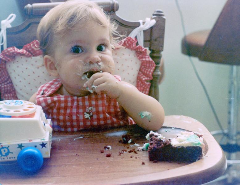 Becky enjoying some cake on (I believe) her first birthday.